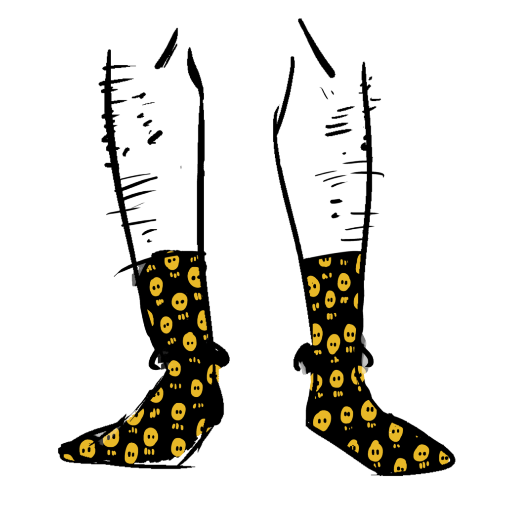 Black socks with a pattern of orange skulls
