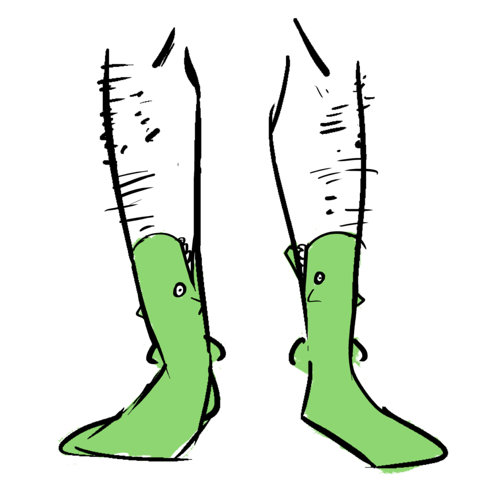 Green socks made to look like an alligator. The top is a mouth.