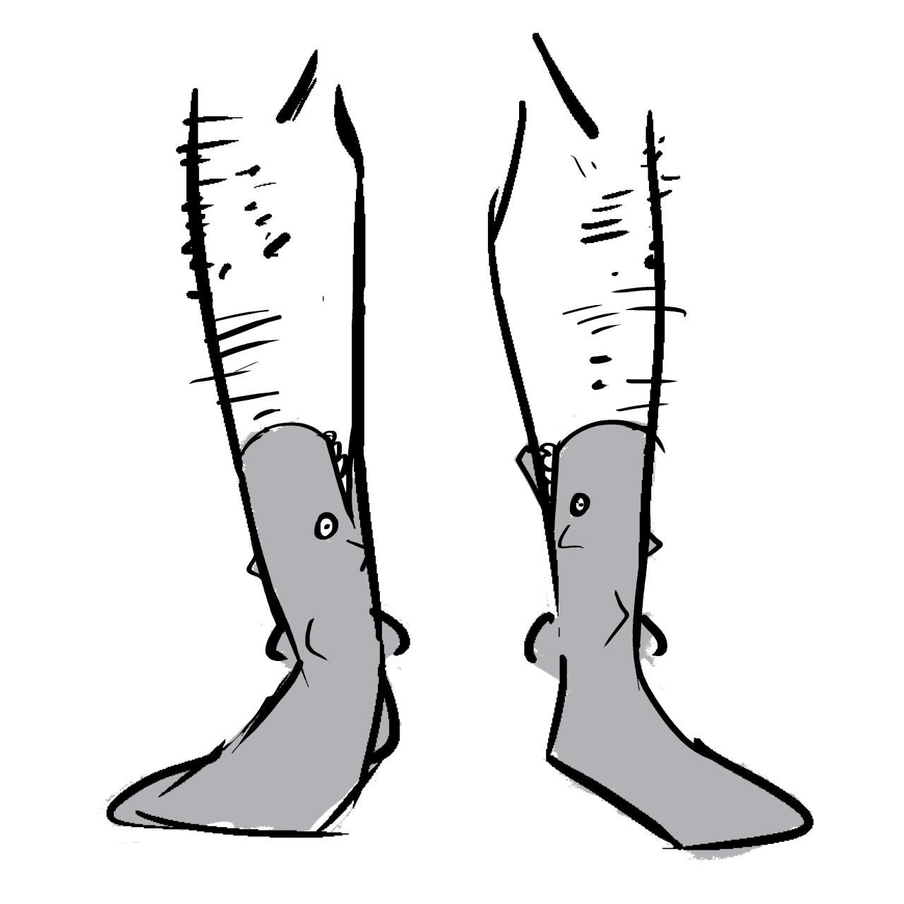 Grey socks made to look like sharks. The tops look like mouths.
