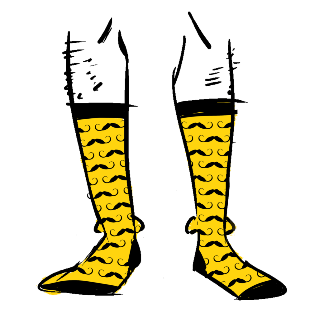"Yellow socks with a pattern of curled ""Dali style"" mustaches on them"