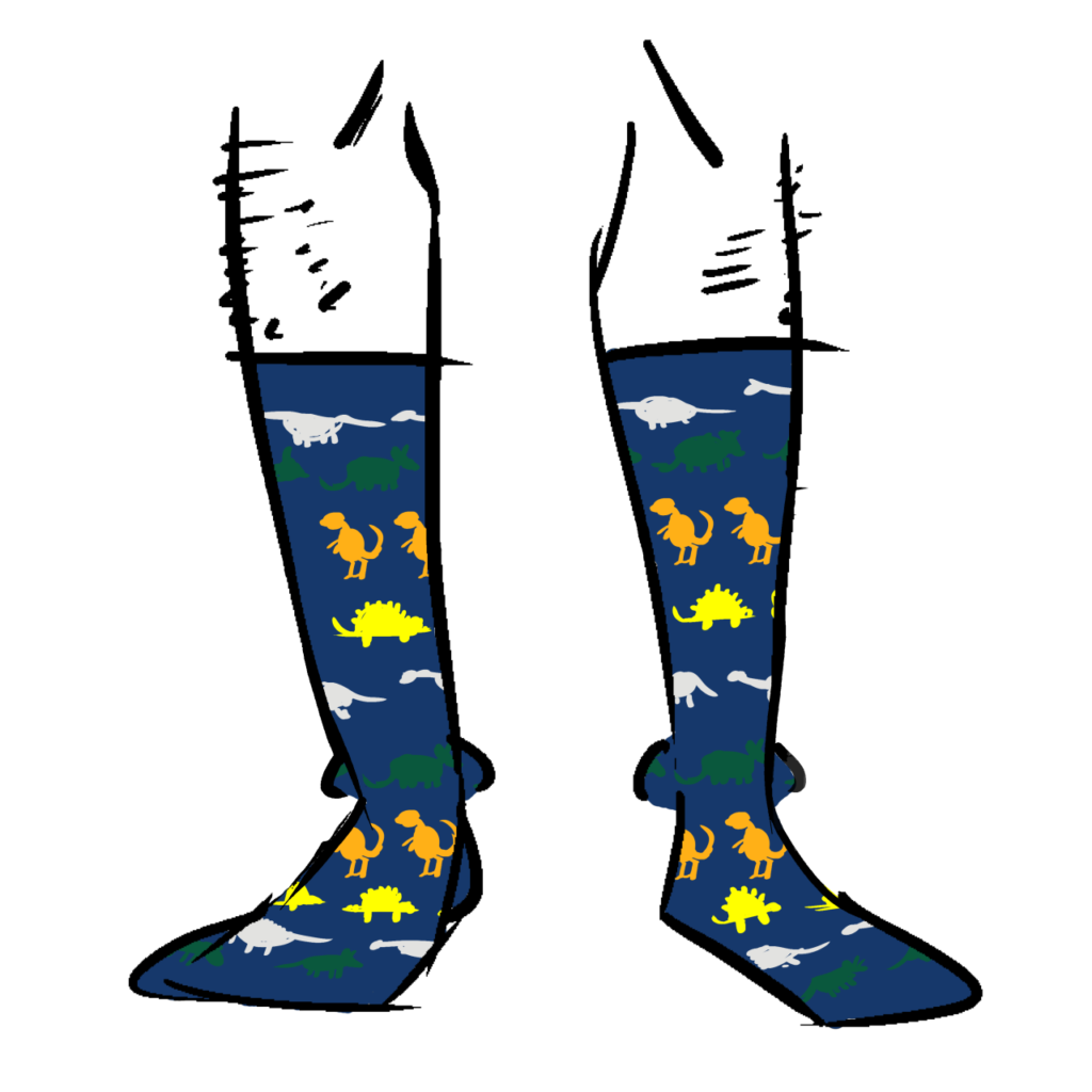 Dark blue socks with green, orange, yellow, and grey dinosaurs on them