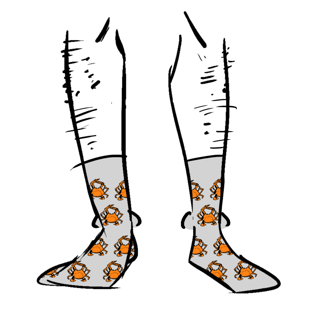 Grey socks with a pattern of orange crabs on them.